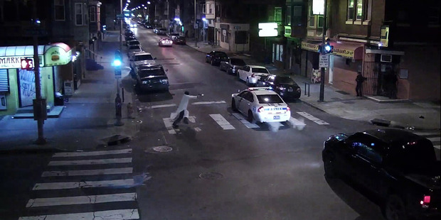 Philadelphia police: Officer shot while in police cruiser